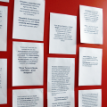 A wall in the mark-making* studio covered in client feedback